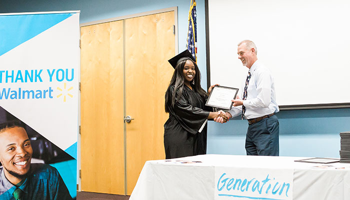 Graduate Aaliyah Belton receives her diploma from Chris Rick, Generation Instructor